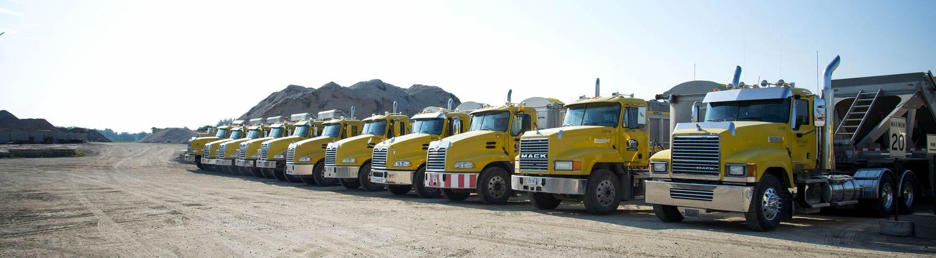 fleet of gravel trucks